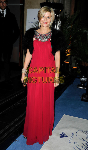 GLYNIS BARBER .At the Grey Goose Character & Cocktails Ball, Grosvenor House Hotel, London, England, UK, December 13th 2009..full length red dress long maxi black fur shrug cropped bolero jacket clutch bag embellished neckline jewelled jewel encrusted .CAP/CAN.©Can Nguyen/Capital Pictures.