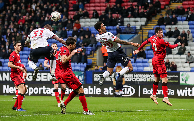 Bolton Wanderers' David Wheater and Josh Magennis can't connect with a corner kick<br /> <br /> Photographer Andrew Kearns/CameraSport<br /> <br /> Emirates FA Cup Third Round - Bolton Wanderers v Walsall - Saturday 5th January 2019 - University of Bolton Stadium - Bolton<br />  <br /> World Copyright © 2019 CameraSport. All rights reserved. 43 Linden Ave. Countesthorpe. Leicester. England. LE8 5PG - Tel: +44 (0) 116 277 4147 - admin@camerasport.com - www.camerasport.com