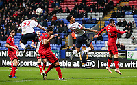 Bolton Wanderers' David Wheater and Josh Magennis can't connect with a corner kick<br /> <br /> Photographer Andrew Kearns/CameraSport<br /> <br /> Emirates FA Cup Third Round - Bolton Wanderers v Walsall - Saturday 5th January 2019 - University of Bolton Stadium - Bolton<br />  <br /> World Copyright &copy; 2019 CameraSport. All rights reserved. 43 Linden Ave. Countesthorpe. Leicester. England. LE8 5PG - Tel: +44 (0) 116 277 4147 - admin@camerasport.com - www.camerasport.com