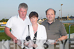 MARKING: Marking their cards at the Kingdom Greyhound Stadium, Tralee on Friday night to raise funds for Coiste Traili, l-r: Bernard and April White (Rathkeale) and James Joy(Abbeyfeale)..