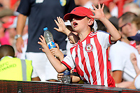A young Brentford fan celebrates their fifth goal during Brentford vs Rotherham United, Sky Bet EFL Championship Football at Griffin Park on 4th August 2018