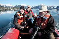 From left, John DeLapp, David Janka and Joe Flynn are all smiles as they travel across Heather Bay in the M/V Auklet's red Zodiac in Prince William Sound, Southcentral Alaska on a sunny spring evening in early May.MR/PR