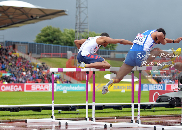 The clouds gather over Gateshead as the mens 110m hurdles carry on. William Sharman (GBR) and Konstadinos Douvalidis (GRE).  Day 2. European Team Athletics Championships. Gateshead. Tyne and Wear. UK. 23/06/2013. <br />  MANDATORY Credit Garry Bowden/SIPPA - NO UNAUTHORISED USE - 07837 394578