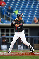 Quad Cities River Bandits shortstop Kristian Trompiz (13) at bat during the first game of a doubleheader against the Wisconsin Timber Rattlers on August 19, 2015 at Modern Woodmen Park in Davenport, Iowa.  Quad Cities defeated Wisconsin 3-2.  (Mike Janes/Four Seam Images)