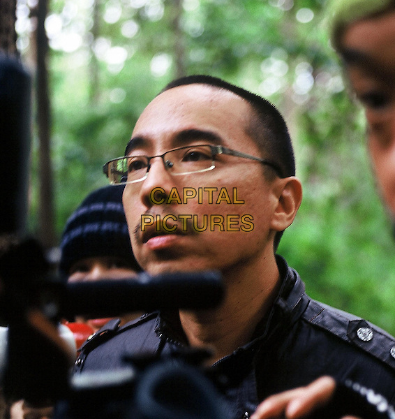 Apichatpong Weerasethakul (Director) <br /> on the set of Presente imperfecto (2015)<br /> (Rak ti Khon Kaen)<br /> *Filmstill - Editorial Use Only*<br /> CAP/NFS<br /> Image supplied by Capital Pictures