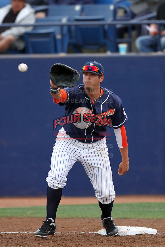 Nick Ramirez #33 of the Cal. St. Fullerton Titans takes a throw at first base against the Cal. St. Long Beach 49'ers at Goodwin Field in Fullerton,California on May 14, 2011. Photo by Larry Goren/Four Seam Images