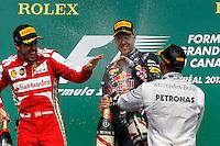 MONTREAL, CANADA, 09.06.2013 - F1 - GP DO CANADÁ - O piloto alemão Sebastian Vettel (C) da equipe Red Bull celebra a viória no Grande Premio de Montreal de Formula 1, no Canadá neste domingo, 09. (Foto: Pixathlon / Brazil Photo Press).