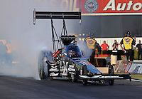 Feb. 14, 2013; Pomona, CA, USA; NHRA top fuel dragster driver Spencer Massey during qualifying for the Winternationals at Auto Club Raceway at Pomona.. Mandatory Credit: Mark J. Rebilas-