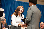 Patti Acosta shakes Jerrick Jones hand and presents him with the East Aldine District Award.