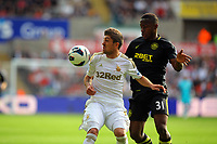 Saturday, 20 October 2012<br /> Pictured L-R: Pablo Hernandez of Swansea challenged by Maynor Figueroa of Wigan<br /> Re: Barclays Premier League, Swansea City FC v Wigan Athletic at the Liberty Stadium, south Wales.