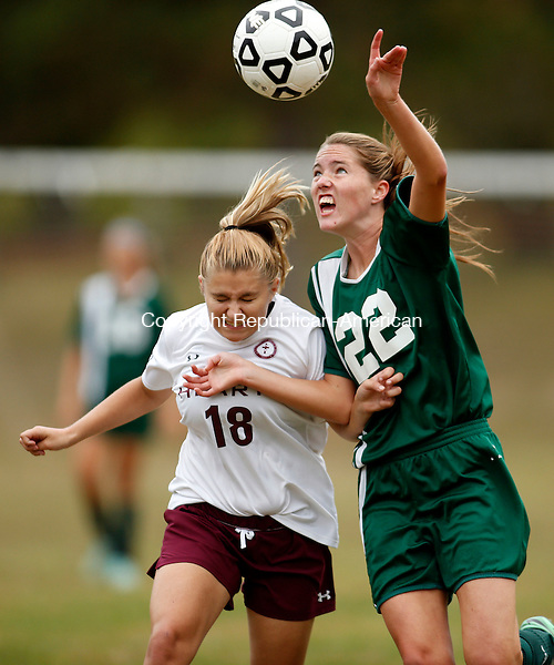 Waterbury, CT- 30 September 2015-093015CM09-   Holy Cross' Jordan Gilmore (22), goes up for the ball against  Sacred Heart's Maria Crean during their NVL matchup at Bucks Hill Park in Waterbury on Wednesday.    Christopher Massa Republican-American