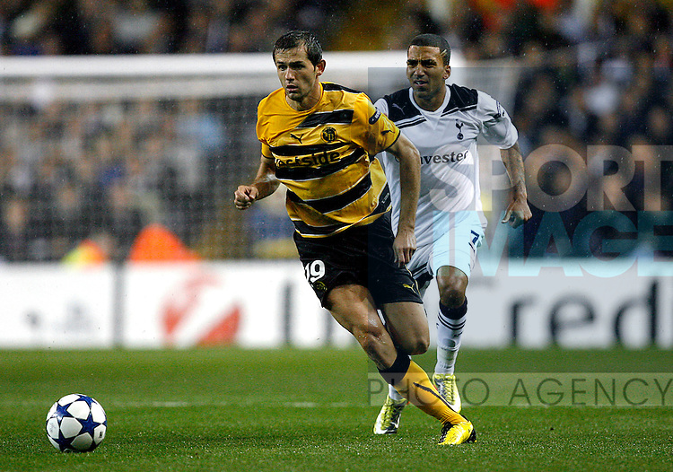 Senad Lulic of Young Boys holds off Aaron Lennon of Tottenham Hotspur
