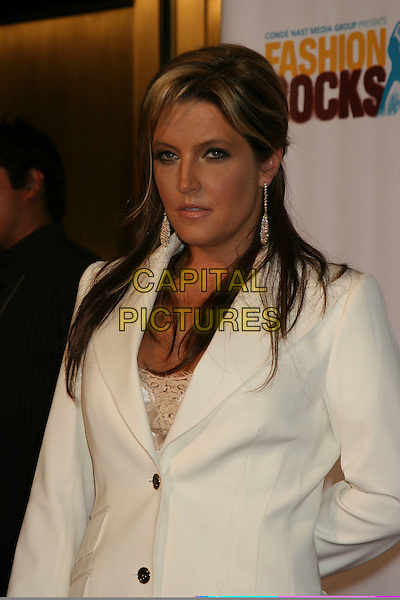 LISA MARIE PRESLEY.Arrivals at Fashion Rocks held at Radio City Music Hall,.New York, 8th September 2005.half length  suit white jacket.Ref: IW.www.capitalpictures.com.sales@capitalpictures.com.©Capital Pictures