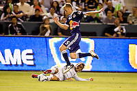 Tim Ream (b) of the New York Red Bulls leaps over LA Galaxy forward David Beckham. The New York Red Bulls beat the LA Galaxy 2-0 at Home Depot Center stadium in Carson, California on Friday September 24, 2010.