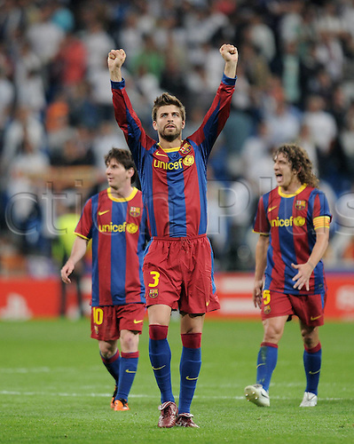 27.04.2011. Lionel Messi scores two late goals during an ill tempered match in which Madrid were reduced to 10 men and Jose Mourinho was sent to the stands. Picture shows Gerard Pique celebrating Barcelona's victory.