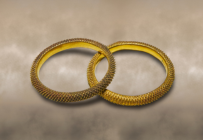 Bronze Age Hattian gold bracelet  from a possible Bronze Age Royal grave (2500 BC to 2250 BC) - Alacahoyuk - Museum of Anatolian Civilisations, Ankara, Turkey. Against a warm art background