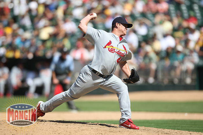 OAKLAND, CA - June 17:  Jason Isringhausen of the St. Louis Cardinals pitches during the game against the Oakland Athletics at the McAfee Coliseum in Oakland, California on June 17, 2007.  The Cardinals defeated the Athletics 10-6.  Photo by Brad Mangin