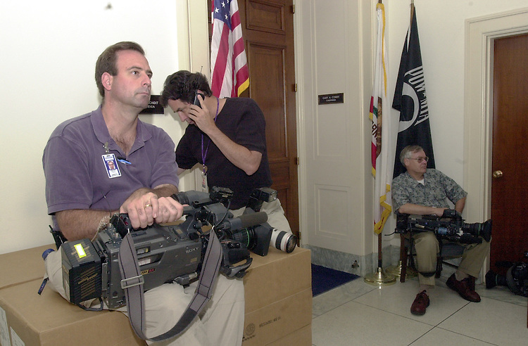 2condit062001 -- Christopher Hamilton of CNN sits with other reporters staked out in front of  Congressman Gary Condit, D-CA, office in Rayburn in hopes of catching the Congressman.