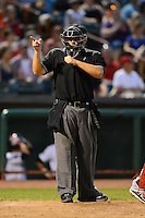 Umpire Mike Savakinas during a game between the Tri-City ValleyCats and Lowell Spinners on July 5, 2013 at Joseph L. Bruno Stadium in Troy, New York.  (Mike Janes/Four Seam Images)