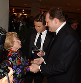 Dr. Ruth Westheimer and Drew Carey shake hands as they arrive at the White House Correspondent's Dinner at the Washington Hilton Hotel in Washington, D.C. on May 4, 2002..Credit: Ron Sachs / CNP