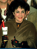 """Actress Elizabeth Taylor gives an enthusiastic """"thumbs up"""" as she kicks off the National AIDS Candle Light March in Washington, D.C. on October 12, 1996..Credit: Ron Sachs / CNP"""