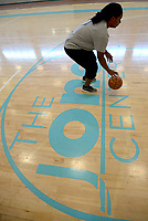 NWA Democrat-Gazette/ANDY SHUPE<br /> Nadiyah Harris, a senior at Har-Ber High School in Springdale, practices free-throws Thursday, July 5, 2018, while working out with her brother, Jeremiah Harris, 11, and her father, Ron Harris, at The Jones Center in Springdale. The Harris family was taking time during an idle time for high school sports to stay in shape before the coming season.