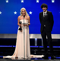SANTA MONICA - JANUARY 13: Lady Gaga and Anthony Rossomando accept the award for Best Song on the 24th Annual Critics' Choice Awards at the Barker Hangar on January 13, 2019, in Santa Monica, California. (Photo by Frank Micelotta/PictureGroup)