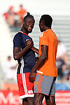 15 June 2016: New England's Kei Kamara (SLE) (left) and Carolina's James Marcelin (HAI) (42) before the game. The Carolina RailHawks hosted the New England Revolution at WakeMed Stadium in Cary, North Carolina in a 2016 Lamar Hunt U.S. Open Cup fourth round game.