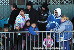 SLUG/USA  Families wait in line for the Los Angeles Mission's Christmas meal service and toy giveaway in the skid row section of Los Angeles, California on December 13, 2011. REUTERS/Jonathan Alcorn (UNITED STATES).