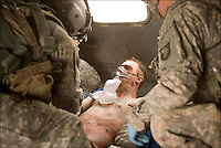 "Medic Staff Sgt. Adam Connaughton, with ""Shadow Dustoff"" C/6-101st Avn Rgt, works on Spc. Mark Baidinger, B Co., 1/502 101st, who was wounded by shrapnel from a recoilless rifle near the Zhari area, Kandahar, September 15, 2010. Coalition forces have been making a big push south to engage this Taliban stronghold near the city."