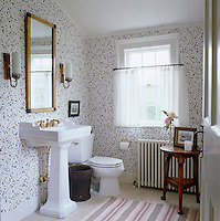 The Hinson's splatter wallpaper in this bathroom is in homage to Billy Baldwin's Nantucket house