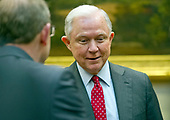 United States Attorney General Jeff Sessions greets members of the Fraternal Order of Police prior to the arrival of US President Donald J. Trump to hosts a listening session in the Roosevelt Room of the White House in Washington, DC on Tuesday, March 28, 2017.<br /> Credit: Ron Sachs / Pool via CNP
