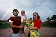 May 6th to 13th, 1985 in Navajo Reserve, AZ. Wilson Dushine family, a Navajo mixed marriage. Family under a rainbow in Window Rock, AZ.