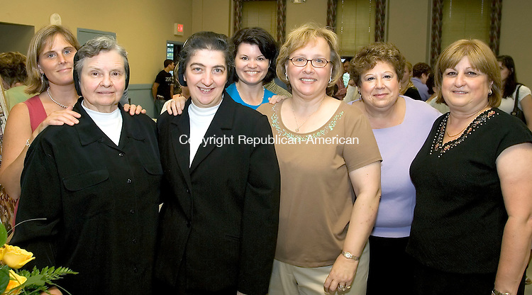 TORRINGTON, CT--25 JUNE 2006 -062506JS03-  Sister Lorraine Chaudron, M.P.F, front left and .St. Peter School principal Sister Annette D'Antonio, M.P.F., with Circle of Friends committee members Tracy Bonvicini, left, Colleen Stack Lynch, Toni Tavano, Maryann Ring and Pat Fairchild during a farewell recepion for the Sisters Larraine and Annette at St. Peters in Torrington.  -- Jim Shannon Republican-American