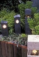 Short pole lighting to illuminate garden path in evening