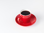 Red espresso coffee cup isolated on white background