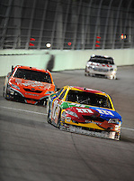 Nov. 16, 2008; Homestead, FL, USA; NASCAR Sprint Cup Series driver Kyle Busch (18) leads Tony Stewart during the Ford 400 at Homestead Miami Speedway. Mandatory Credit: Mark J. Rebilas-