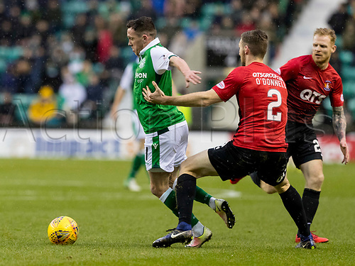 30th December 2017, Easter Road, Edinburgh, Scotland; Scottish Premier League football, Hibernian versus Kilmarnock; Danny Swanson of Hibernian gets past Stephen O'Donnell of Kilmarnock