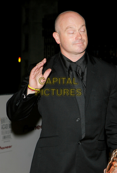 "ROSS KEMP.Winner of the Best Factual Series Award for ""Ross Kemp on Gangs"".The British Academy Television Awards (BAFTA) afterparty at the Natural History Museum, London, England. .May 20th, 2007.half length black suit jacket hand eyes closed funny face.CAP/AH.©Adam Houghton/Capital Pictures"