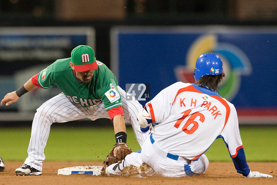 15 March 2009: #15 #15 Yong Kyu Lee of Korea slides as #2 Edgar Gonzalez of Mexico tags him during the 2009 World Baseball Classic Pool 1 game 2 at Petco Park in San Diego, California, USA. Korea wins 8-2 over Mexico.