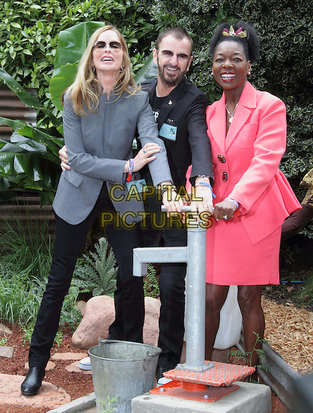 Barbara Bach, Ringo Starr and Floella Benjamin.RHS Chelsea Flower Show Press and VIP Day at Royal Hospital Chelsea, London, England..May 21st 2012.full length black suit beard facial hair sunglasses shades grey gray water pump married husband wife pink skirt.CAP/ROS.©Steve Ross/Capital Pictures.