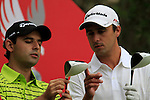 Mines bigger than yours ! as Rafa Echenique and Fabrizio Zanotti wait to tee off on the 10th tee to start his round during Thusday Day 1 of the Abu Dhabi HSBC Golf Championship, 20th January 2011..(Picture Eoin Clarke/www.golffile.ie)
