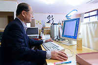 Founder of the Irodori Project, Tomoji Yokoishi, in his office, Kamikatsu, Katsuura, Tokushima Prefecture, Japan, July 7, 2014. The Irodori Project is based in the mountain town of Kamikatsu, Tokushima Prefecture. Farmers - many of them elderly - grow leaves and flowers to use to decorate Japanese food in restaurants and hotels across the nation.