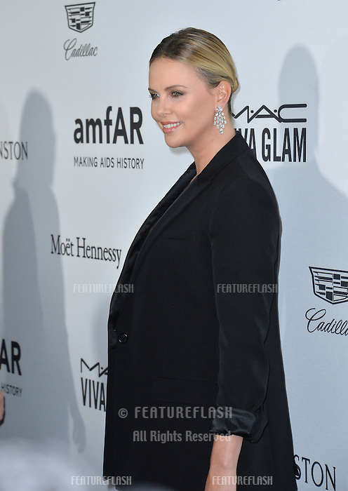 LOS ANGELES, CA. October 27, 2016: Charlize Theron at the 2016 amfAR Inspiration Gala at Milk Studios, Los Angeles.<br /> Picture: Paul Smith/Featureflash/SilverHub 0208 004 5359/ 07711 972644 Editors@silverhubmedia.com