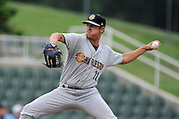 Starting pitcher Caleb Smith (12) of the Charleston RiverDogs delivers a pitch in a game against the Kannapolis Intimidators on Saturday, June 28, 2014, at CMC-Northeast Stadium in Kannapolis, North Carolina. Kannapolis won, 4-3. (Tom Priddy/Four Seam Images)
