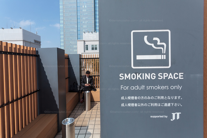 Smoking area on the roof of Mitsukoshi Department Store in Nihonbashi, Tokyo, Japan. Friday March 4th 2016