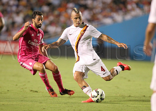 29.07.2014. Dallas, Texas, USA.  AS Roma midfielder Radja Nainggolan (#4) passes the ball as Real Madrid defender Alvaro Arbeloa (#17) defends during the International Champions Cup match between Real Madrid and AS Roma at the Cotton Bowl in Dallas, Texas.  AS Roma won the game 1-0.