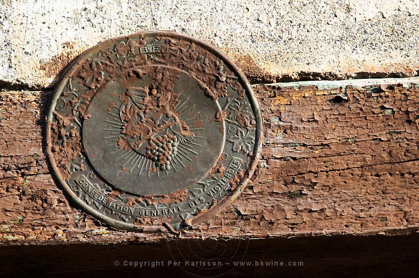 Old label sign for wine makers association. La Liquiere village. Faugeres. Languedoc. France. Europe.
