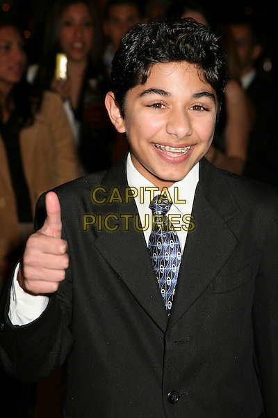 MARK INDELICATO .The 8th Annual Family Television Awards at the Beverly Hilton Hotel, Beverly Hills, California, USA..November 29th, 2006.half length black braces teeth thumb up.CAP/ADM/BP.©Byron Purvis/AdMedia/Capital Pictures
