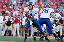 25 September, 2010: South Dakota State quarterback Thomas O'Brien #4 ready to handoff the ball in the game against Nebraska at Memorial Stadium in Lincoln, Nebraska. Nebraska defeated South Dakota State 17 to 3.